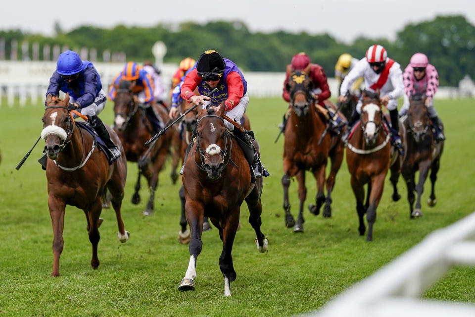 Jockey James Doyle (C) wearing the Queen's silks riding Tactical wins The Windsor Castle Stakes on day two of the Royal Ascot horse racing meet, in Ascot, west of London, on June 17, 2020, which is taking place behind 'closed doors' due to the ongoing novel coronavirus pandemic. (Photo by Alan Crowhurst / POOL / AFP) (Photo by ALAN CROWHURST/POOL/AFP via Getty Images)