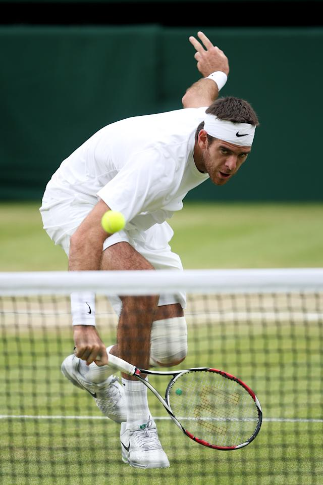 LONDON, ENGLAND - JULY 03: Juan Martin Del Potro of Argentina plays a backhand during the Gentlemen's Singles quarter-final match against David Ferrer of Spain on day nine of the Wimbledon Lawn Tennis Championships at the All England Lawn Tennis and Croquet Club at Wimbledon on July 3, 2013 in London, England. (Photo by Clive Brunskill/Getty Images)