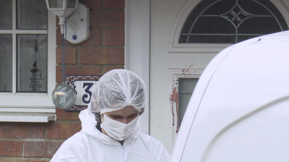Forensic police attend the scene where two teenage boys were stabbed to death Saturday night following an altercation, in Milton Keynes, southern England, Sunday Oct. 20, 2019.  One of the the 17-year-old victims, who have not been named by police, died at the scene, while the other died early Sunday morning in hospital. (Andy Wasley/PA via AP)