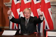 Britain's Prime Minister Boris Johnson gives a double thumbs up after signing the post-Brexit trade deal with the EU