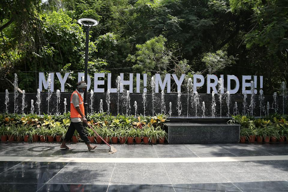 NEW DELHI, INDIA - AUGUST 14: A worker cleans the premises of the pilot project at Chirag Delhi-Sheikh Sarai stretch which has been beutified and redeveloped on the line of European standards, on August 14, 2021 in New Delhi, India.  (Photo by Sanchit Khanna/Hindustan Times via Getty Images)