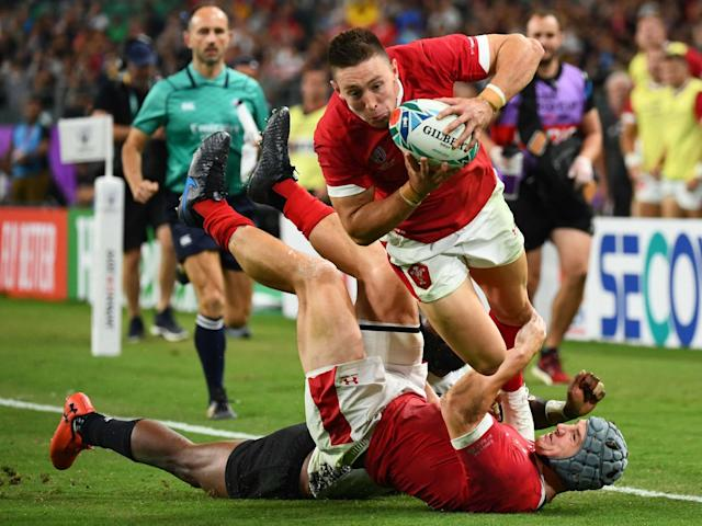 Wales' wing Joshua Adams scores a try: AFP via Getty Images