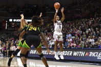 Connecticut's Crystal Dangerfield shoots over Oregon's Sabrina Ionescu, back left, and Oregon's Ruthy Hebard, foreground, in the first half of an NCAA college basketball game, Monday, Feb. 3, 2020, in Storrs, Conn. (AP Photo/Jessica Hill)