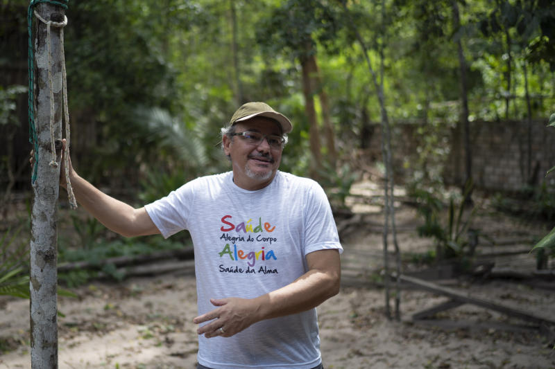 "In this Dec. 1, 2019 photo, Caetano Scannavino, coordinator of NGO ""Saude e Alegria,"" or Health and Happiness, gives an interview outside his home in Alter do Chao, Para state, Brazil. The sleepy Amazon town has become the flashpoint for the growing hostility between Brazil's far-right President Jair Bolsonaro and environmental groups following the arrest of firefighters he says set rainforest fires. (AP Photo/Leo Correa)"
