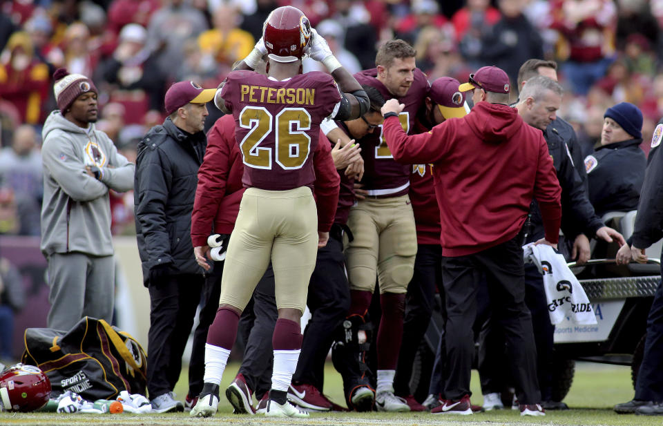 Washington Redskins quarterback Alex Smith (11) is carted off the field against the Houston Texans in an NFL game, Sunday, November 18, 2018 in Landover, Md. (AP Photo/Daniel Kucin Jr.)