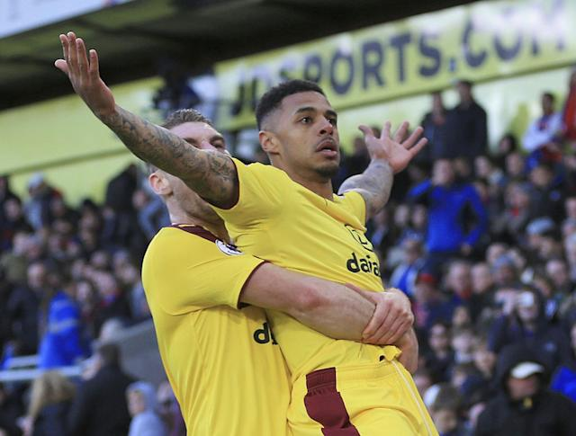 <p>Andre Gray of Burnley celebrates scoring his team's second goal with Sam Vokes during the Premier League match between Crystal Palace and Burnley at Selhurst Park </p>