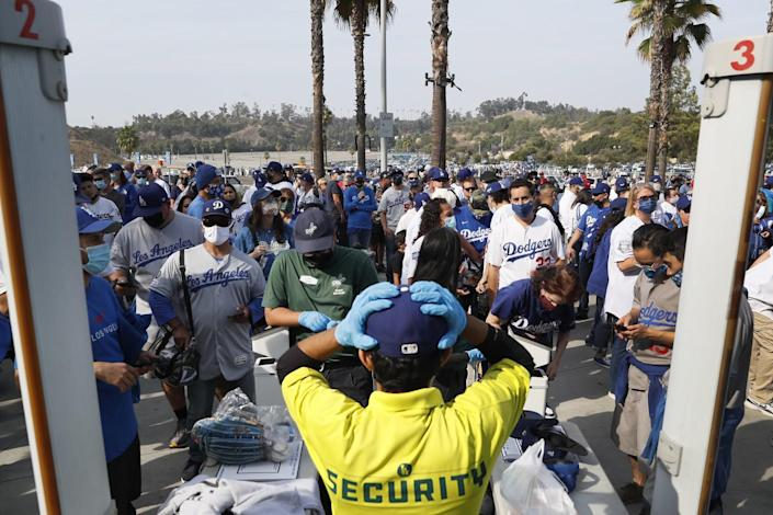 Fans gather outside the left field gate hours before the game between the Los Angeles Dodgers and the St. Louis Cardinals