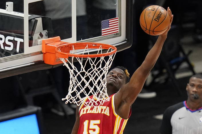 Atlanta Hawks center Clint Capela goes to the basket during the second half of the team's NBA basketball game against the Utah Jazz Friday, Jan. 15, 2021, in Salt Lake City. (AP Photo/Rick Bowmer)