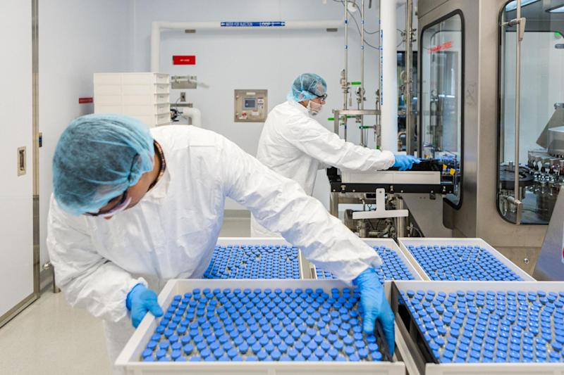Lab technicians load filled vials of investigational coronavirus disease treatment drug remdesivir at a facility in La Verne, California: via REUTERS