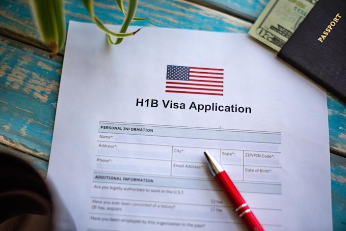 Illustrative picture showing application for United States of America work visa H1B with pen