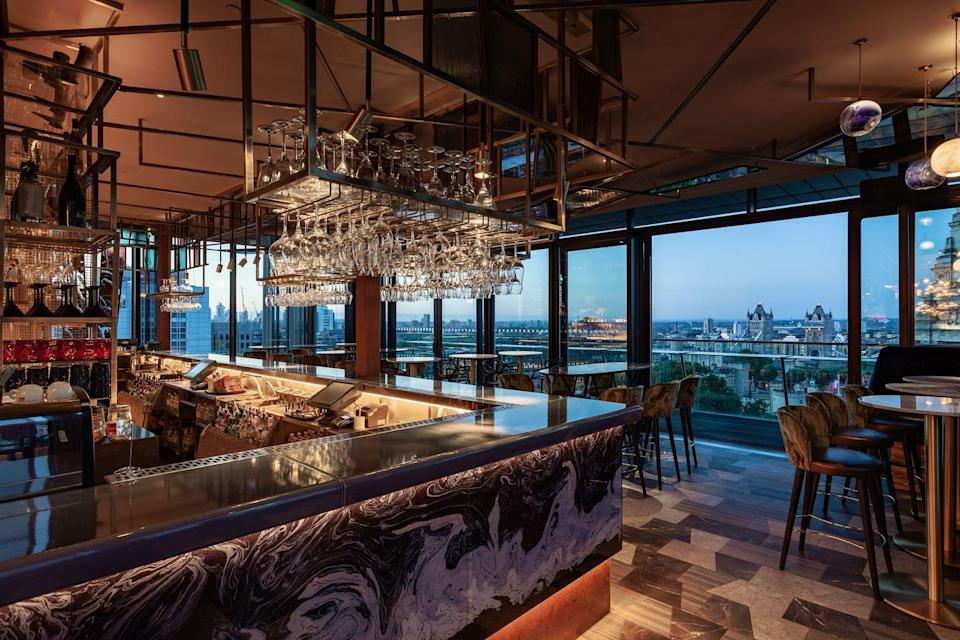 """<p>Located on the 12th floor of the DoubleTree Hilton hotel next to the Tower of London is Savage Garden which offers panoramic views looking out over the city, with unique close-up views of the Tower of London and Tower Bridge.</p><p>Cocktail wise, the modern venue puts a modern twists on the classics. For instance, with the 'Savage Spritz' which is Plymouth sloe gin, bitters and champagne.</p><p>Food wise, there's a vast offering of meat, pescatarian, veggie and vegan sharing platters and individual mains on offer. There's only one dessert on the menu but we highly recommend it. Two words: 'Injectable doughnuts'.</p><p>Find <a href=""""https://www.youtube.com/watch?v=xgW8DuK_PxE&t=63s"""" rel=""""nofollow noopener"""" target=""""_blank"""" data-ylk=""""slk:Savage Garden"""" class=""""link rapid-noclick-resp"""">Savage Garden </a>at 7 Pepys Street.</p>"""