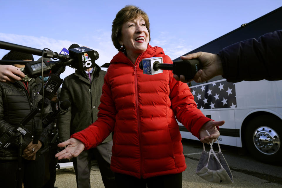 FILE - In this Nov. 4, 2020, file photo Republican Sen. Susan Collins, R-Maine, speaks to reporters in Bangor, Maine.A bipartisan group of lawmakers, including Collins, is putting pressure on congressional leaders to accept a split-the-difference solution to the months-long impasse on COVID-19 relief in a last-gasp effort to ship overdue help to a hurting nation before Congress adjourns for the holidays. (AP Photo/Robert F. Bukaty, File)