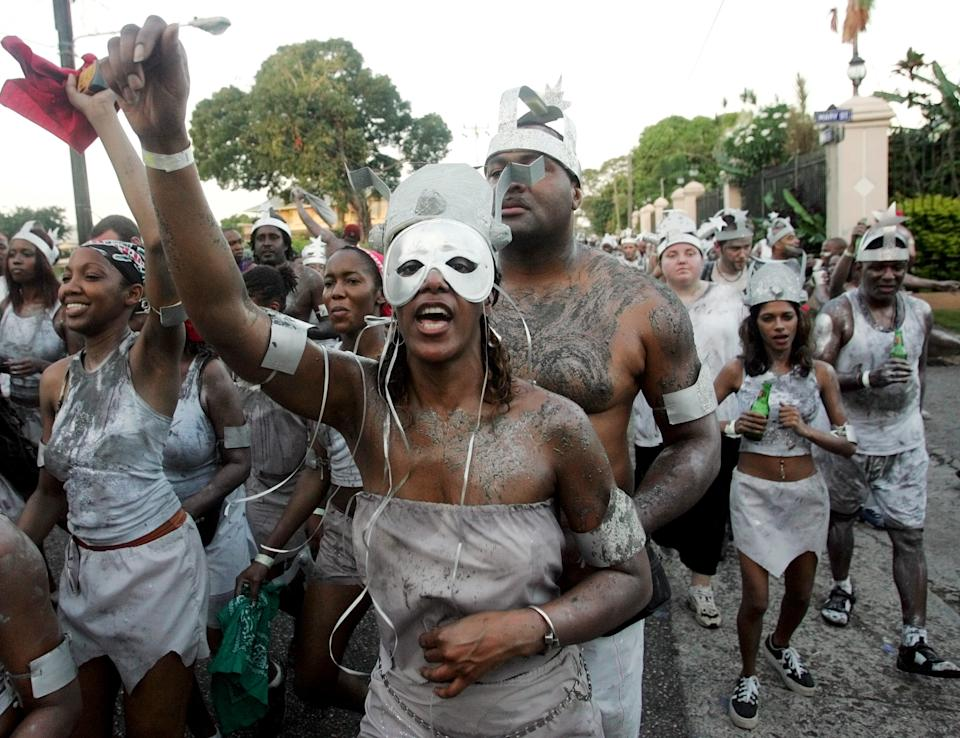 Revelers parade during a 'J Overt' (The Beginning) parade as part of Carnival festivities in Port of Spain, Trinidad and Tobago, February 7, 2005. REUTERS/Jorge Silva  JS/HB