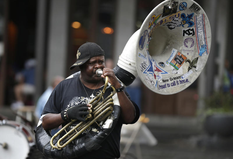 Street musicians perform for festival go-ers in Jackson Square on the first day of the annual French Quarter Festival in New Orleans, Thursday, April 11, 2013. French Quarter Festival, which turns 30 this year, runs through Sunday and showcases Louisiana food and music on stages strung throughout the historic neighborhood, including Jackson Square, the French Market, along narrow streets and on the Mississippi riverfront. The lineup includes Irma Thomas, trumpeter Kermit Ruffins, Cajun fiddler Amanda Shaw, the Dirty Dozen Brass Band and about 250 other acts. (AP Photo/Gerald Herbert)
