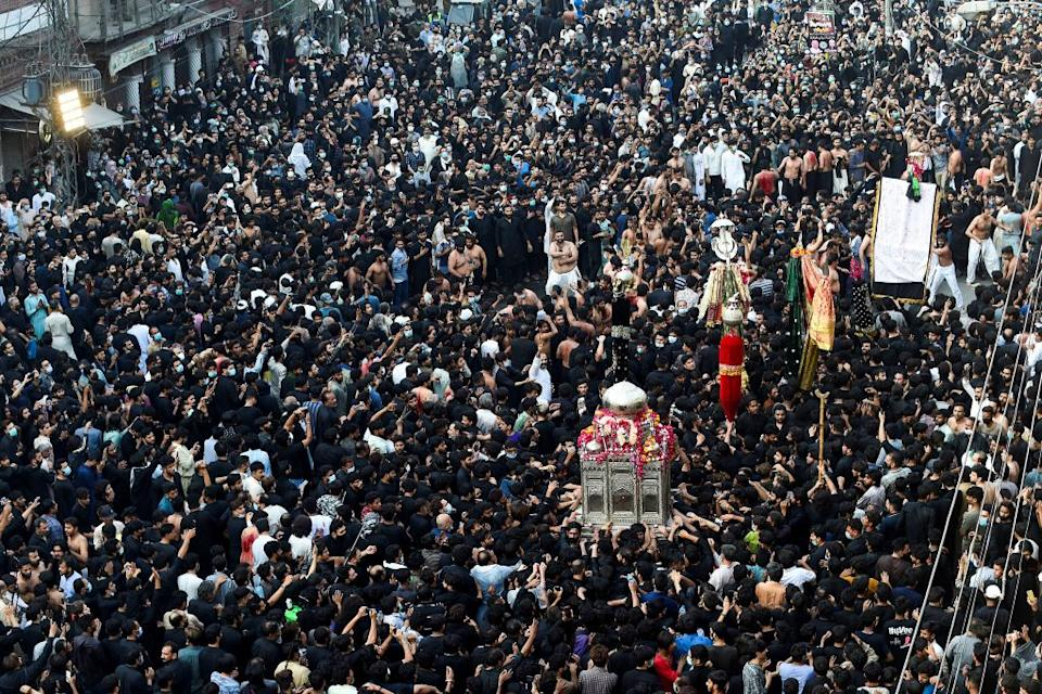 Shiite Muslim devotees take part in a procession to commemorate the death anniversary of Prophet Mohammad's companion and son-in-law Imam Ali.