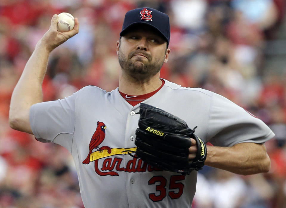 St. Louis Cardinals starting pitcher Jake Westbrook throws against the Cincinnati Reds in the first inning of a baseball game, Saturday, Aug. 3, 2013, in Cincinnati. (AP Photo/Al Behrman)