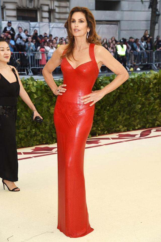 <p>Crawford looked red hot in Versace. (Photo: Getty Images) </p>