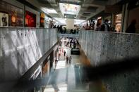 People are seen in a shopping mall on the first day of the opening of malls after a country lockdown, amid the coronavirus disease (COVID-19) pandemic, in Sintra