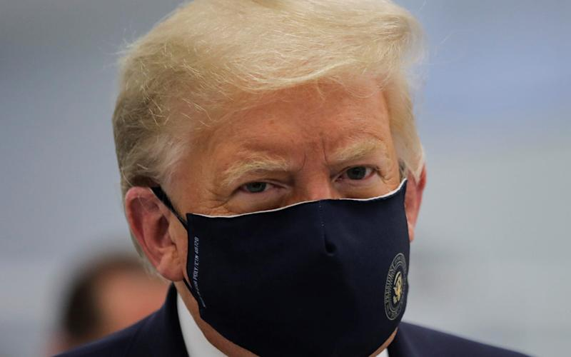President Donald Trump wears a protective face mask during a tour of the Fujifilm Diosynth Biotechnologies' Innovation Center, where components for a potential coronavirus disease vaccine are being produced - Reuters