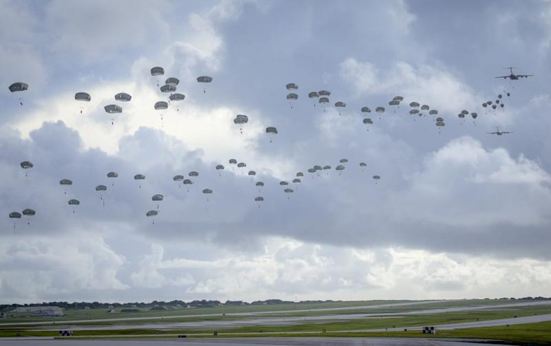 US Army paratroopers jump over Guam