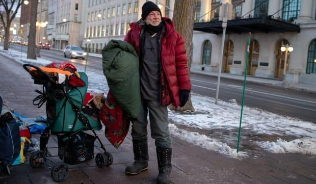 CBC photographer Andrew Lee captured thousands of images in the past year, many focusing on poverty, including this picture of a homeless man on Wellington Street in Ottawa.