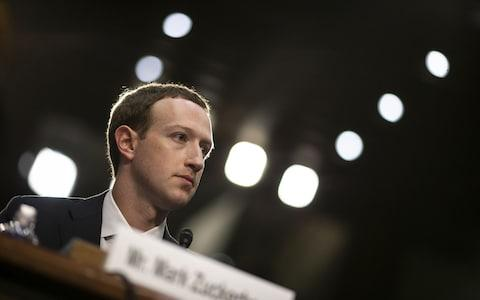 Mark Zuckerberg, chief executive officer and founder of Facebook Inc., listens during a joint hearing of the Senate Judiciary and Commerce Committees in Washington - Credit: Bloomberg