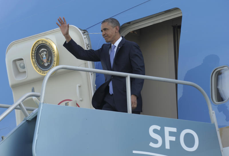 President Barack Obama waves from the top of the steps of Air Force One at San Francisco International Airport in San Francisco, Wednesday, April 3, 2013. Obama will be attending Democratic fundraisers while in California. (AP Photo/Susan Walsh)