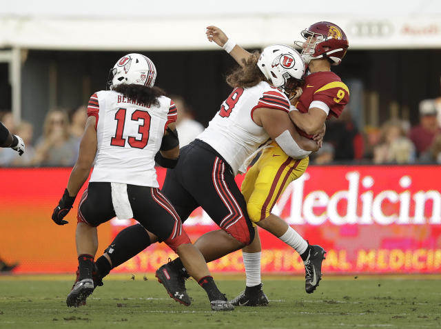 Southern California quarterback Kedon Slovis (9) is hit by by Utah defensive tackle Leki Fotu during the first half of an NCAA college football game Friday, Sept. 20, 2019, in Los Angeles. (AP Photo/Marcio Jose Sanchez)