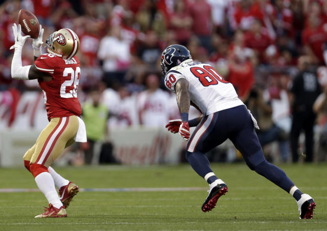 San Francisco 49ers cornerback Tramaine Brock, left, intercepts a pass intended for Houston Texans wide receiver Andre Johnson, right, in the first half of an NFL football game in San Francisco, Sunday, Oct. 6, 2013. (AP Photo/Marcio Jose Sanchez)