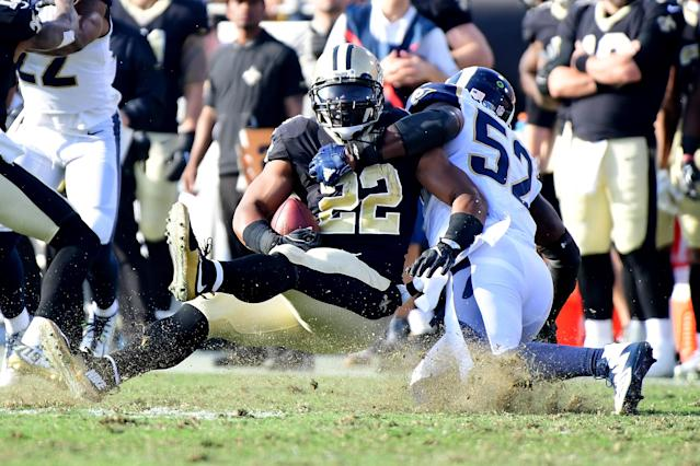 <p>Alec Ogletree #52 of the Los Angeles Rams tackles Mark Ingram #22 of the New Orleans Saints on the third down during the second quarter of the game at the Los Angeles Memorial Coliseum on November 26, 2017 in Los Angeles, California. (Photo by Harry How/Getty Images) </p>
