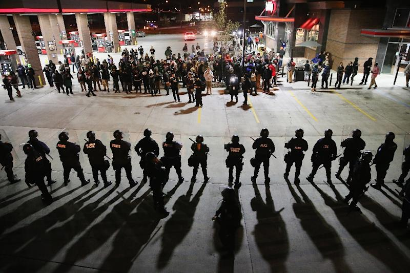 Demonstrators protesting the killings of Michael Brown and Vonderrit Myers are confronted by police in riot gear on October 12, 2014 in St Louis, Missouri (AFP Photo/Scott Olson)