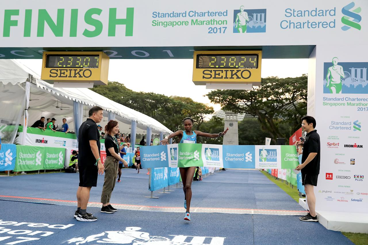 <p>Pamela Jepkosgei Rotich from Kenya was the first woman to arrive at the finish line for the full marathon of Standard Chartered Singapore Marathon 2017, with an official time of 02:38:31.<br /> Photo: Standard Chartered Singapore Marathon 2017 </p>