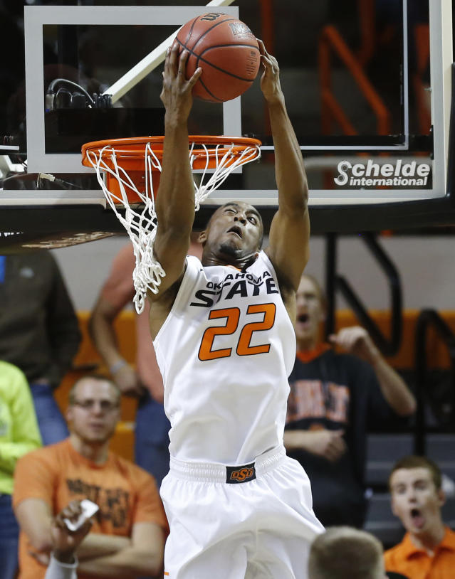 Oklahoma State's Markel Brown dunks against Utah Valley in the first half of an NCAA college basketball game in Stillwater, Okla., Tuesday, Nov. 12, 2013. (AP Photo/Sue Ogrocki)