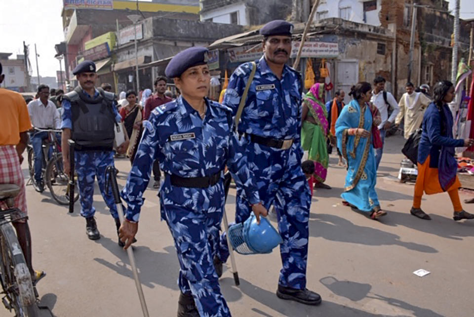 Rapid Action Force (RPF) personnel patrol on a street in Ayodhya on November 8, 2019, ahead of a Supreme Court verdict on the future of a disputed religious site. - Indian police have arrested more than 500 people ahead of a Supreme Court ruling on a hotly disputed religious site in the holy city of Ayodhya, media reports said, with authorities fearing the verdict could trigger unrest. (Photo by STR / AFP) (Photo by STR/AFP via Getty Images)