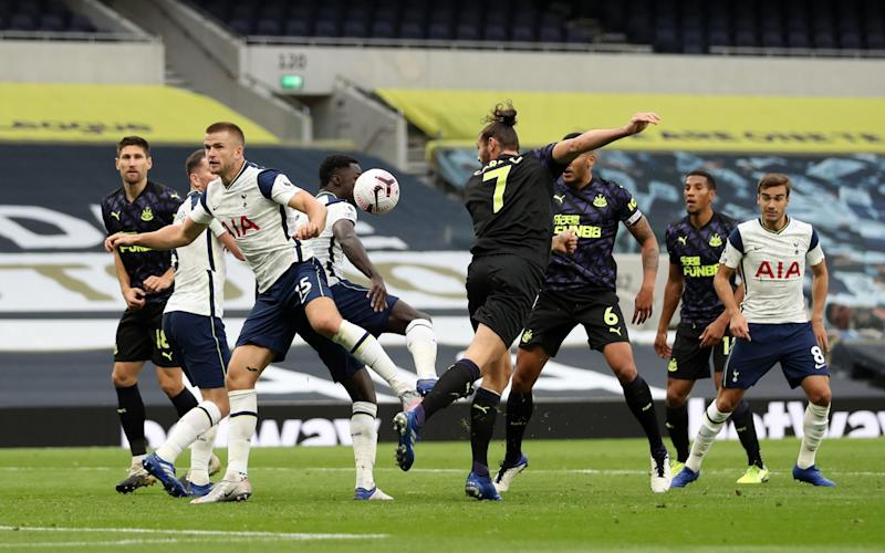 The ball hits the arm of Eric Dier of Tottenham Hotspur leading to a penalty during the Premier League match between Tottenham Hotspur and Newcastle United at Tottenham Hotspur Stadium on September 27, 2020 in London, England.  - GETTY IMAGES