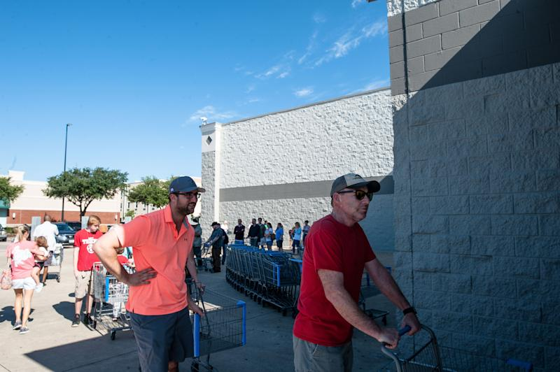 People wait in line to get into Wal-Mart in Katy, Texas on Wednesday.  (Joseph Rushmore for HuffPost)