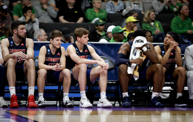 Liberty players sit on the bench during their loss against Virginia Tech during a second-round game in the NCAA men's college basketball tournament Sunday, March 24, 2019, in San Jose, Calif. (AP Photo/Ben Margot)