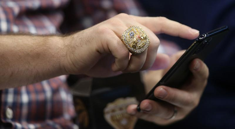 Everybody wants to get their hands on a Raptors replica ring. (Getty Images)