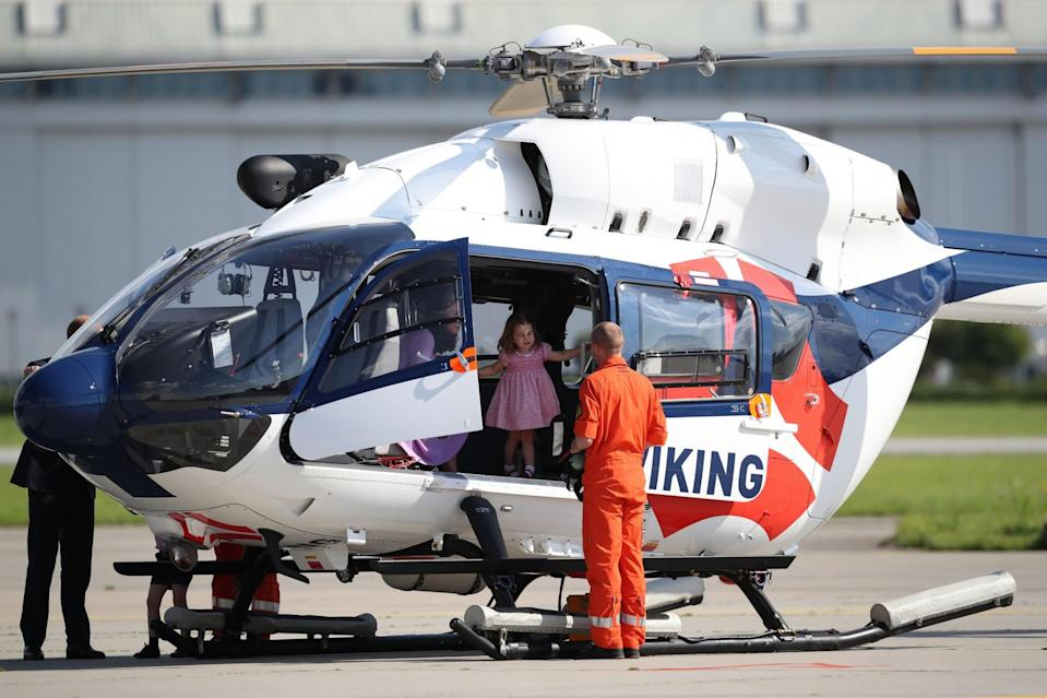 <p><b><b><b>The Duchess of Cambridge and Princess Charlotte explore the inside of a helicopter at Airbus in Hamburg. <br><em>[Photo: PA]</em> </b></b></b></p>