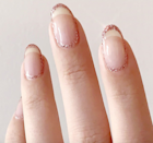 For just a touch of sparkle, surround the outline of your nails with a delicate glitter.