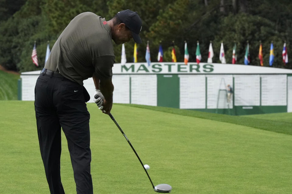 Tiger Woods tees off on the first hole during the first round of the Masters golf tournament Thursday, Nov. 12, 2020, in Augusta, Ga. (AP Photo/David J. Phillip)