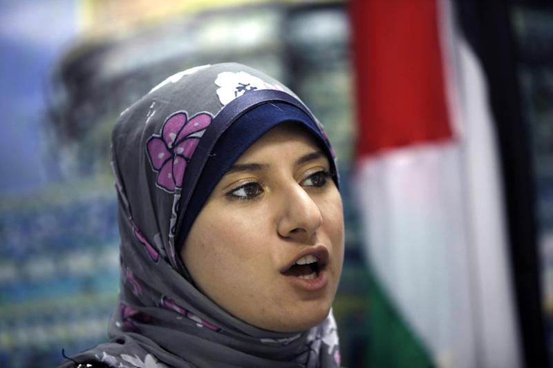 In this Wednesday, Nov. 6, 2013 photo, Isra Almodallal, 23, the first woman to be appointed as a spokesperson for Hamas, the conservative Islamist group that rules the Gaza Strip, speaks during an interview at Hamas information ministry in Gaza City. The appointment of Almodallal as a spokeswoman for the Hamas-dominated Gaza government, which has at times sought to curb women's freedoms, indicates an attempt by the group to project a new, friendlier face abroad. (AP Photo/Adel Hana)