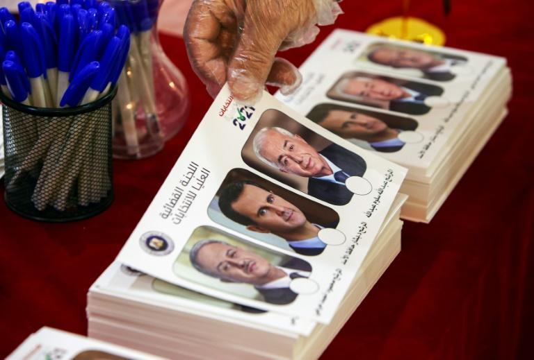 A ballot bearing the images of presidential candidates Mahmoud Merhi (L), President Bashar al-Assad (C) and Abdullah Salloum Abdullah (R), seen here in elections held at the Syrian embassy in Kuwait on May 20