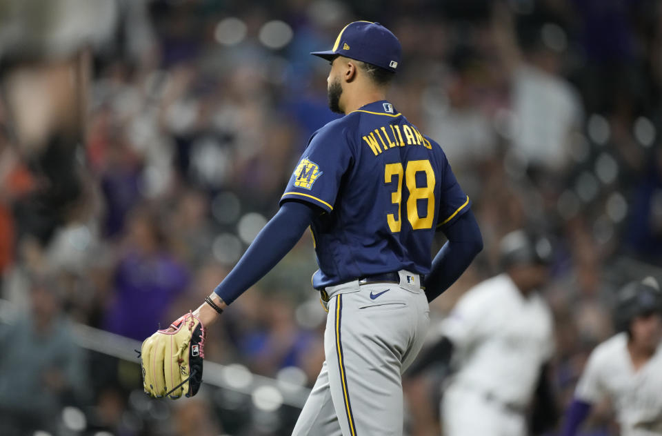 Milwaukee Brewers relief pitcher Devin Williams starts to walk off the field after Colorado Rockies' C.J. Cron hit a single to drive in the winning run in the 10th inning of a baseball game Friday, June 18, 2021, in Denver. The Rockies won 6-5. (AP Photo/David Zalubowski)