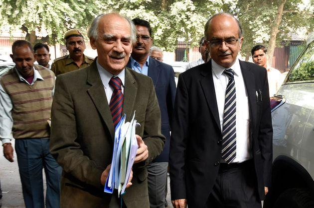 NEW DELHI, INDIA NOVEMBER 14: Former Union Minister Arun Shourie and lawyer-activist Prashant Bhushan walk out of the Supreme Court after the hearing for the probe in to alleged Rafale scam, on November 14, 2018 in New Delhi, India.