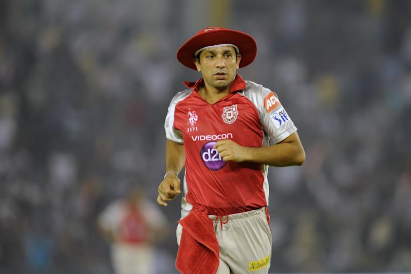 Kings XI Punjab player Azhar Mahmood runs during the IPL Twenty20 match between Kings XI Punjab and Deccan Chargers at the Punjab Cricket Association (PCA) stadium in Mohali on  May 13, 2012