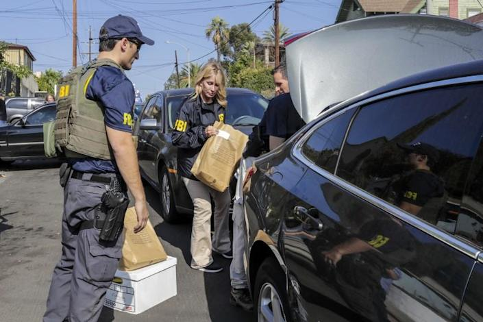 """The FBI raids City Councilman Jose Huizar's residence in Boyle Heights on Nov. 7, 2018. Former city officials suggest a commission could help prevent similar scandals. <span class=""""copyright"""">(Los Angeles Times)</span>"""