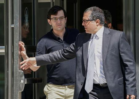 FILE PHOTO  Former drug company executive Martin Shkreli exits U S   District Court after being convicted. Shkreli ordered jailed for online bounty on Hillary Clinton s hair