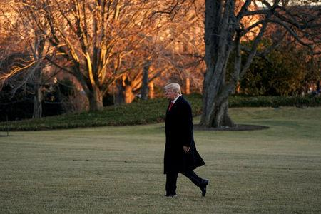 President Donald Trump walks on South Lawn of the White House upon his return in Washington