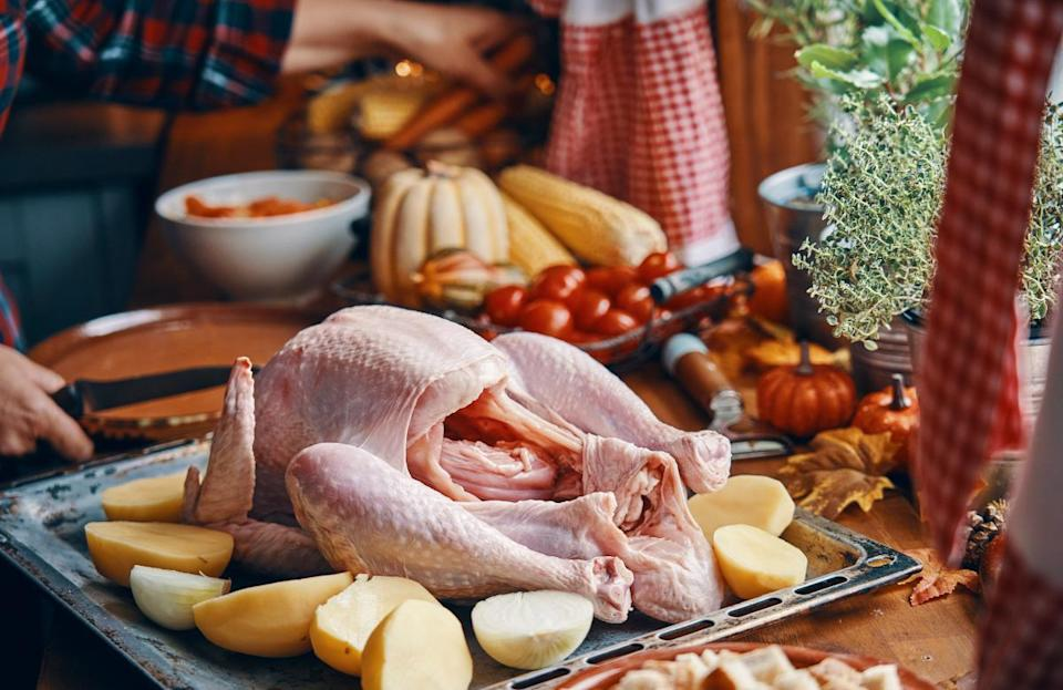 """<p>Absolutely not. Washing your chicken or turkey in the sink just splashes raw juices around and <a href=""""https://www.thedailymeal.com/healthy-eating/washing-your-chicken-will-turn-your-kitchen-biohazard-zone?referrer=yahoo&category=beauty_food&include_utm=1&utm_medium=referral&utm_source=yahoo&utm_campaign=feed"""" rel=""""nofollow noopener"""" target=""""_blank"""" data-ylk=""""slk:will turn your kitchen into a biohazard zone"""" class=""""link rapid-noclick-resp"""">will turn your kitchen into a biohazard zone</a>. Instead, just pat your turkey dry inside and out with some paper towels before seasoning.</p>"""